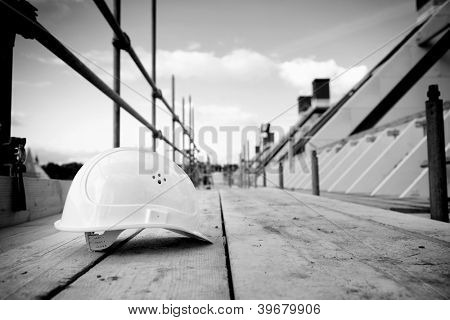 empty building site with left helmet on scaffold