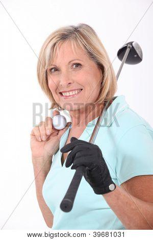 Mature female golfer