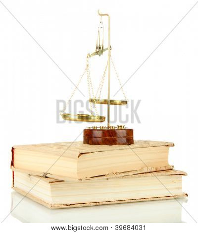 Gold scales of justice and books isolated on white