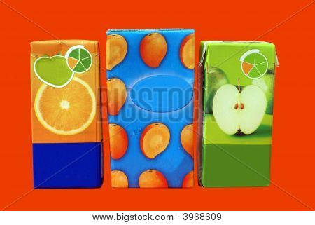 Packs Of Cardboard For Orange, Apple, & Mango Juice Drinks.