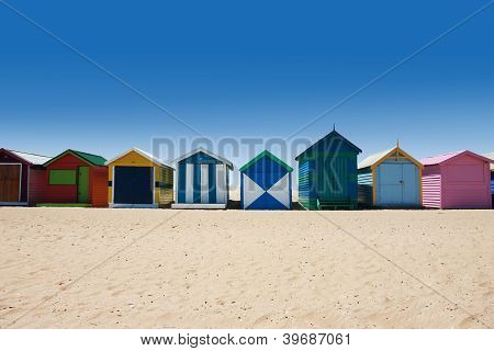Bright And Colorful Houses On White Sand Beach