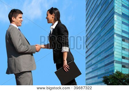 Business Couple Shaking Hands Over Deal Outdoors.