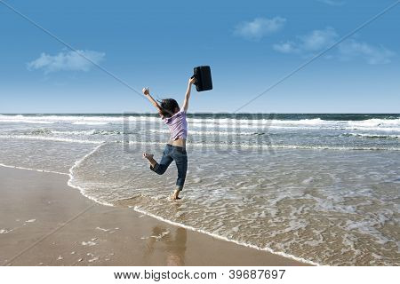 Excited Woman With Laptop On Beach