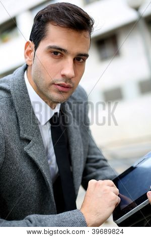 Trendy young businessman working outside the office