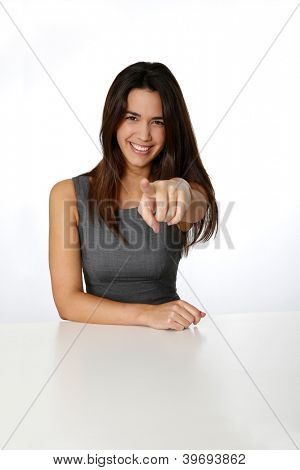 Smiling woman pointing arm towards camera