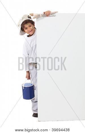 little boy dressed in house painter