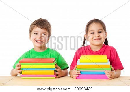 Kids with pile of books