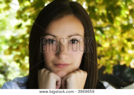 Beautiful Teenager With Leaves In The Background