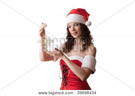 Santa girl holding snowflake