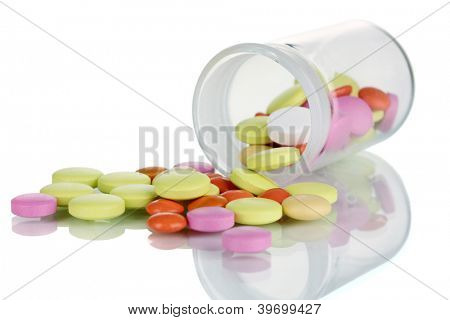 Pills in receptacle isolated on white