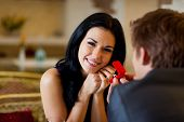 foto of propose  - marriage proposal, man give ring to his girl, young happy couple romantic date at restaurant, celebrating valentine day