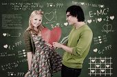 stock photo of goofy  - Cute nerd guy is giving his girlfriend Valentine - JPG