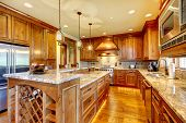 stock photo of sink  - Mountain luxury home with wood kitchen and granite countertop - JPG