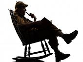 image of sherlock  - sherlock holmes reading silhouette sitting in rocking chair in studio on white background - JPG
