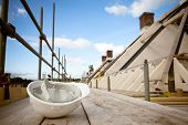 stock photo of scaffolding  - empty building site with left helmet on scaffold - JPG