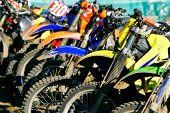 stock photo of moto-x  - row of motobikes close up at wheels - JPG