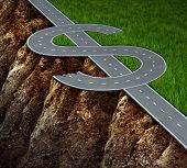 stock photo of shaky  - Financial cliff or fiscal risk and dangerous challenges regarding the risk in investing and finance management pit falls with a highway in the shape of a dollar symbol on the edge of a hazardous cliff - JPG