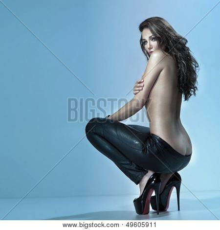 Brunette Woman In Sensual Pose, Looking At Camera.