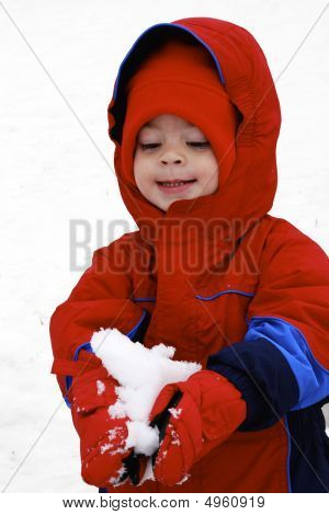 Child Playing The Snow