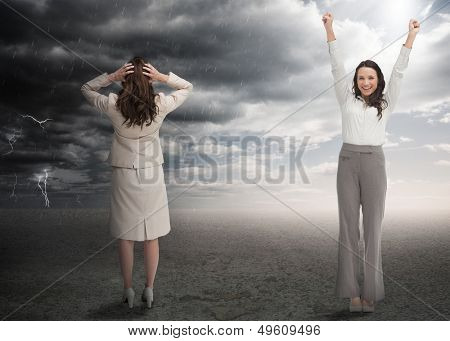Successful and stressed businesswomen in contrasting weather