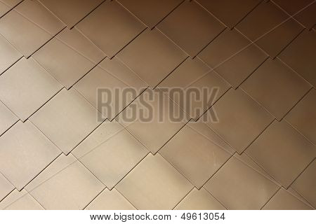 Gold-coloured metal scales on modern building #3