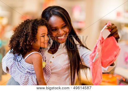 Portrait of a mother and daughter shopping for clothes