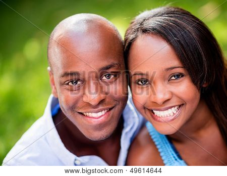 Portrait of a beautiful couple smiing outdoors
