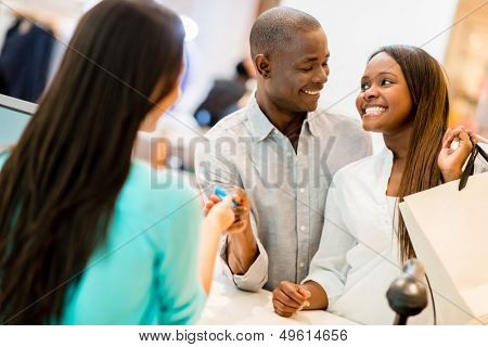 Happy couple shopping and making payment with a credit card