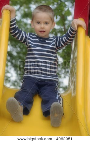 Young Boy Is Playing Outdoor - On Chute