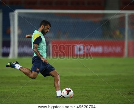 KUALA LUMPUR - AUGUST 9: FC Barcelona's Dani Alves practices during training at the Bukit Jalil Stadium on August 09, 2013 in Malaysia. FC Barcelona is on an Asia Tour to Malaysia.