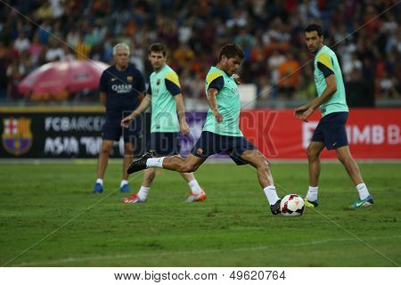 KUALA LUMPUR - AUGUST 9: FC Barcelona player Jonathan Dos Santos shoots during training at the Bukit Jalil National Stadium on August 09, 2013 in Malaysia. FC Barcelona is on an Asia Tour to Malaysia.