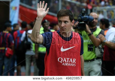 KUALA LUMPUR - AUGUST 10: FC Barcelona 's Lionel Messi waves to the fans before the match against Malaysia starts at the Shah Alam Stadium on August 10, 2013 in Malaysia. FC Barcelona wins 3-1.