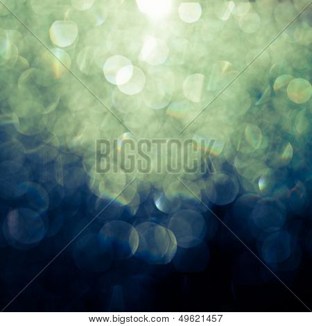 Abstract background (raindrops on a window dispersing and reflecting light)