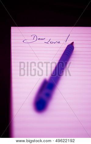 Dear Love handwritten  on a notepad with a pink cast