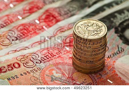 Fifty pounds sterling an coin stack - UK Currency - Macro