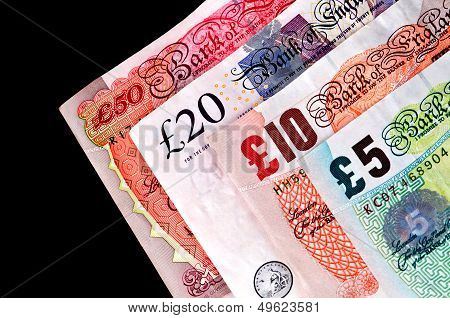 English British banknotes all four paper money diagonally arranged