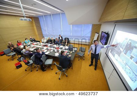MOSCOW - DEC 20: Members at the table are looking at the board on Business Breakfast at the office Rosbank on December 20, 2012 in Moscow Russia.