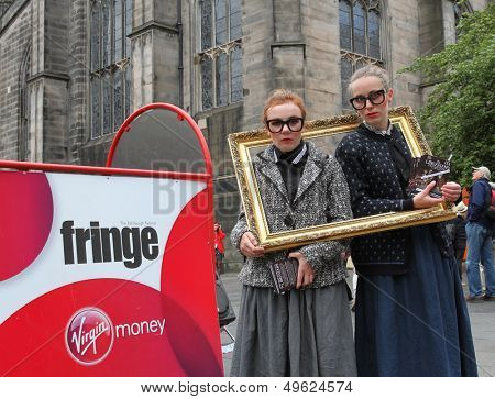 EDINBURGH- AUGUST 10: Members of Minotaur Theatre Company publicize their show The Librarians during Edinburgh Fringe Festival on August 10, 2013 in Edinburgh, Scotland