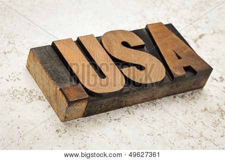 dot USA - internet concept - fictitious  domain address (not .us) - letterpress wood type on ceramic tile background