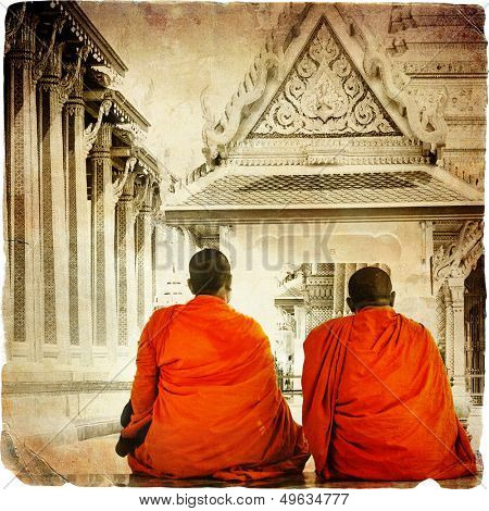 two monks in Thai temple - artistic toned picture in retro style