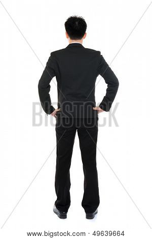 Rear or back view full body Asian business man in formal suit standing isolated on white background