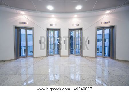 Four transparent elevator door in the business center