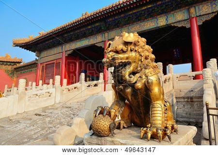 Lion statue and historical architecture in Forbidden City in Beijing, China.