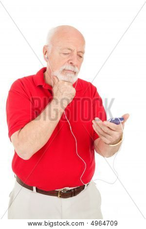 Senior Man Confused By Mp3 Player