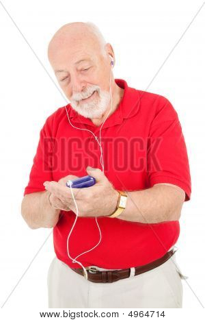 Senior Man Using Mp3 Player