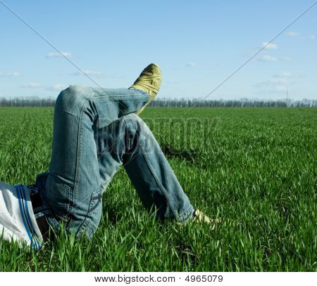 Male Legs On The Green Field