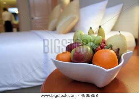 Fruits On Bed In Five Star Hotel Room