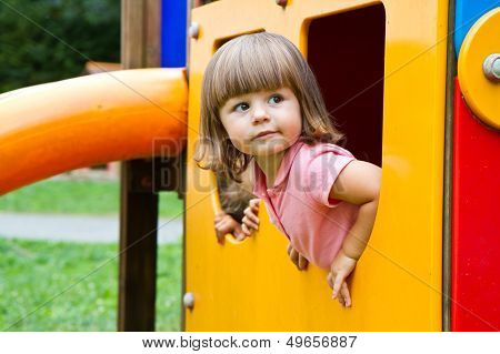 Happy Smiling Child   In Small House On Playground