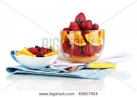 Useful fruit salad in glass cup isolated on white