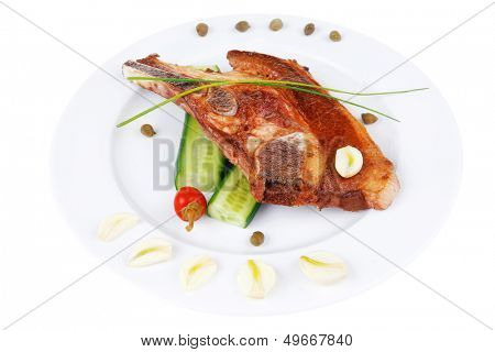 fresh grilled beef meat fillet on white plate with tomatoes and capers isolated  over white background